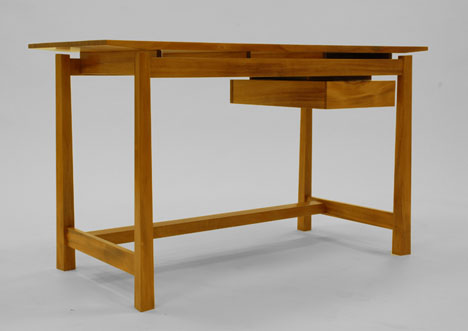 el efecto de y el nico cajn totalmente a la vista hacen que el escritorio luzca liviano y flexible